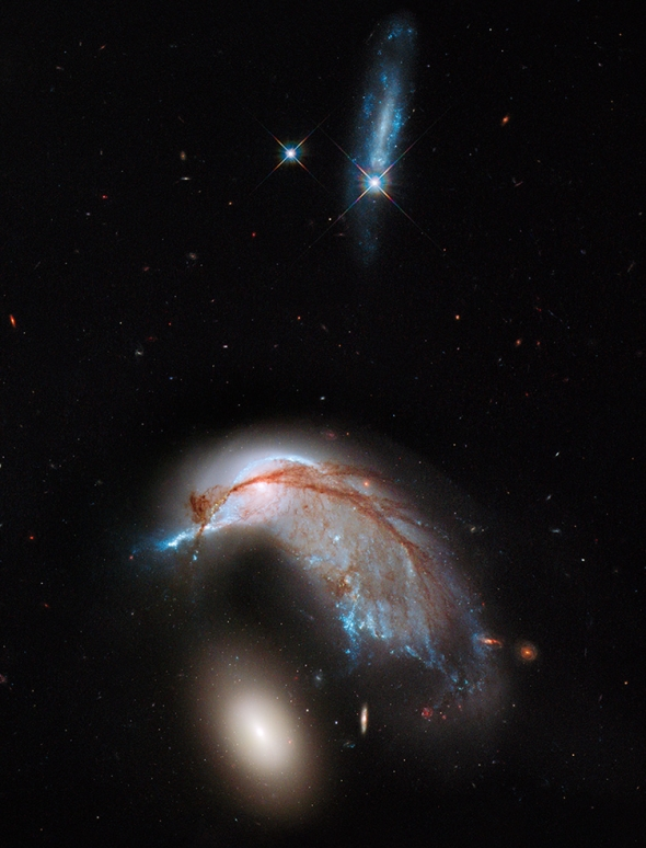 Today's Universe is prettier, and lumpier, than the early Universe. (Interacting galaxies Arp 142. Image: NASA, ESA, and the Hubble Heritage Team (StSci/AURA))