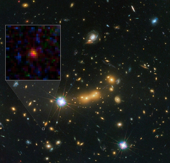 The current contender for the most distant galaxy known: a tiny red blob called MACS0647-JD. Credit: Credit: NASA, ESA, and M. Postman and D. Coe (STScI) and CLASH Team.