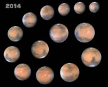 14 depictions of Mars - appearing as red-coloured circles - arranged in a spiral on a black background; text '2014' appears in the top left corner