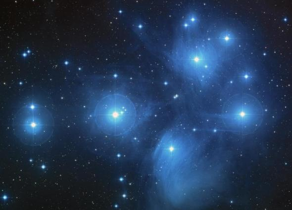 Black background with numerous bright blue-white stars.