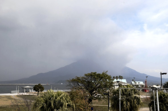 Sakurajima partially obscured by an ash cloud from an eruption that morning.