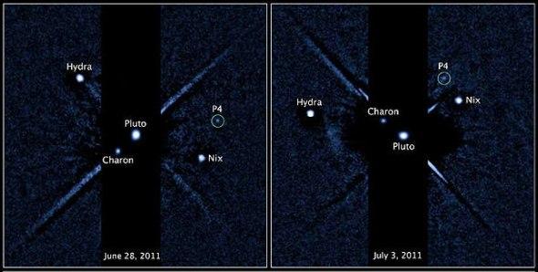 Hubble Space Telescope image of the Pluto system. Image: STScI, NASA, ESA, M.Showalter (SETI)