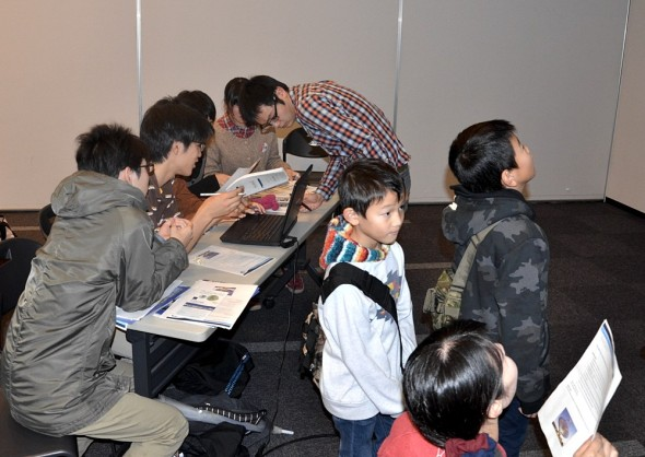 Students analysing their data whilst some young members of the public view the telescope in action at Sendai.