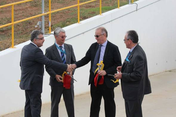 CONGRATULATIONS: NASA's Mr Badri Younes (left) shakes hands with CSIRO's Dr Dave Williams following the ribbon cutting with CDSCC Director, Dr Ed Kruzins (2nd left) and NASA's Mr Pete Vrotsos (right) at the commissioning of Deep Space Station 35.